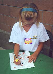 a girl coloring Star
